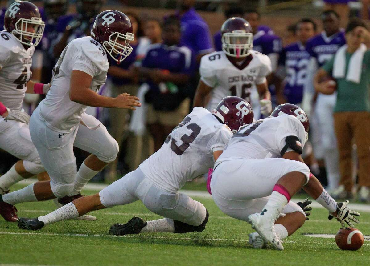 Cinco Ranch defensive lineman Lee Thomas recovers a fumble during the first half of a football game against Morton Ranch, at Rhodes Stadium, Thursday, Oct. 2, 2014, in Katy.