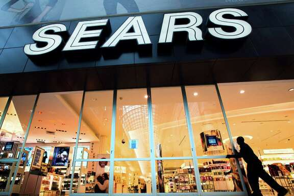 The Sears store at Eaton Centre in Toronto opens its doors for business. Sears Canada also has been struggling financially as competitors like Target have entered the Canadian market.