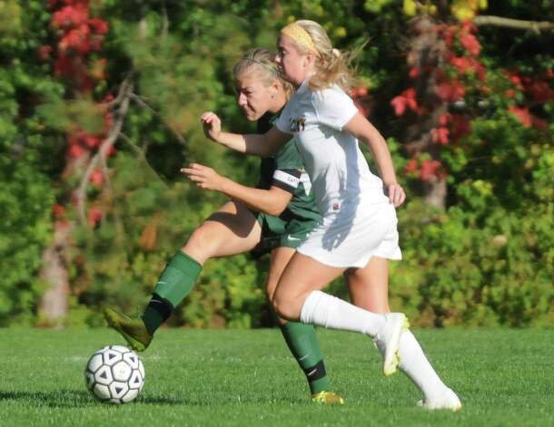 Schalmont's Hailee Metzoldi, left, moves the ball up the field during their high school soccer game against Albany Academy on Thursday Oct. 2, 2014 in Albany, N.Y.  (Michael P. Farrell/Times Union) Photo: Michael P. Farrell / 10028820A