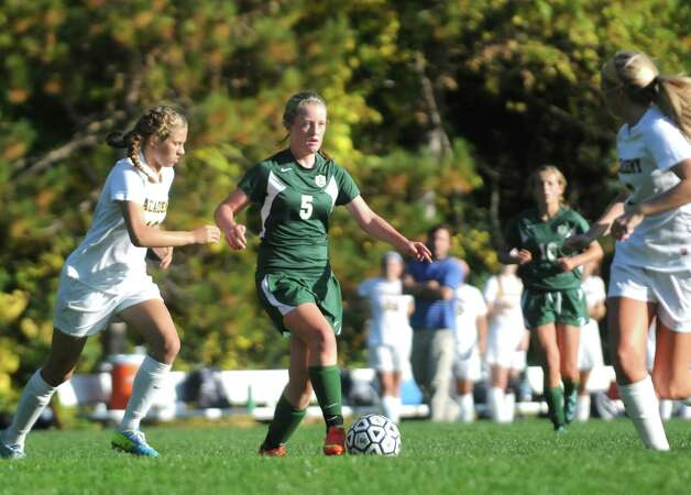 Schalmont's Hailee Metzoldi, center, moves the ball up the field during their high school soccer game against Albany Academy on Thursday Oct. 2, 2014 in Albany, N.Y.  (Michael P. Farrell/Times Union) Photo: Michael P. Farrell / 10028820A