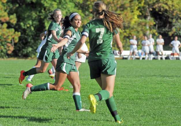 Schalmont's, left to right, Molly Older,  Bianca Mascitelli and Hailee Metzold celebrate after Metzold scored a goal during their high school soccer game against Albany Academy on Thursday Oct.2 , 2014 in Albany, N.Y.  (Michael P. Farrell/Times Union) Photo: Michael P. Farrell / 10028820A