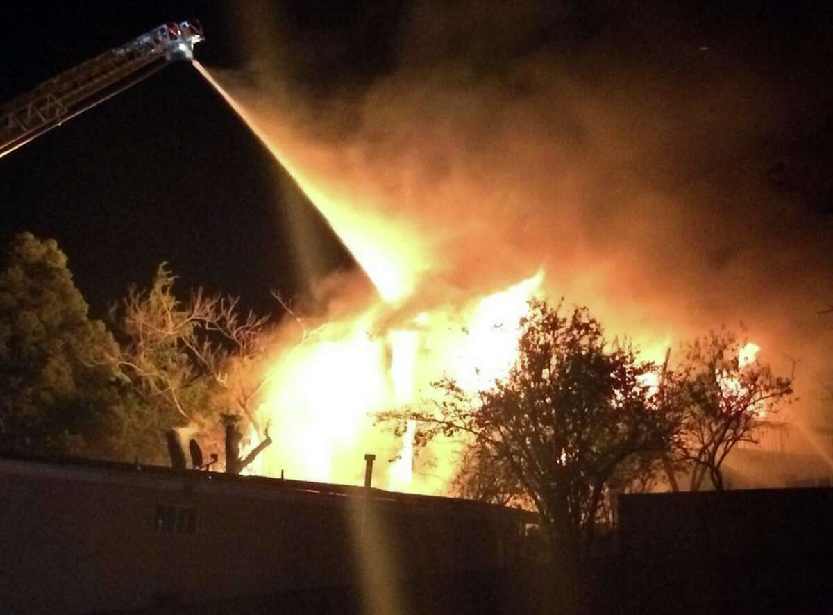 Firefighters in Oakland battle a three-alarm blaze on Thursday, Oct. 2, 2014.