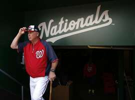 Washington Nationals pitching coach Steve McCatty (54) walks to the field during an MLB baseball workout at Nationals Park, Thursday, Oct. 2, 2014, in Washington. The Washington Nationals play the San Francisco Giants in the National League Division Series starting Friday. (AP Photo/Alex Brandon)