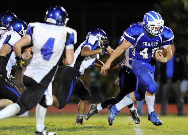 Shaker's Ryan Duda, right, carries the ball closer the the end zone during their football game against La Salle on Thursday, Oct. 2, 2014, at Shaker High in Latham, N.Y. (Cindy Schultz / Times Union) Photo: Cindy Schultz / 00028778A