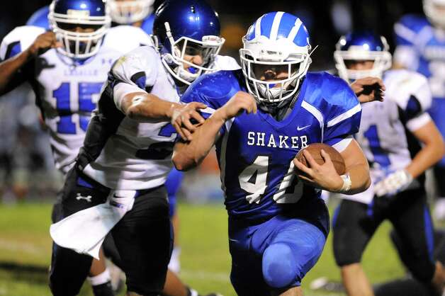 Shaker's Ryan Duda, right, gains yards as La Salle's Joe Germinerio defends during their football game on Thursday, Oct. 2, 2014, at Shaker High in Latham, N.Y. (Cindy Schultz / Times Union) Photo: Cindy Schultz / 00028778A