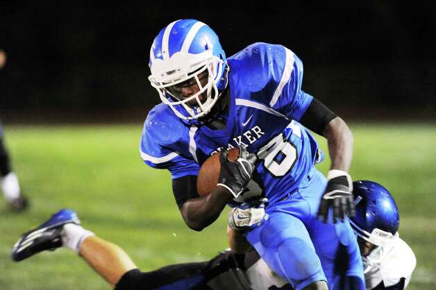 Shaker's Andrew Bolton, right, gains yards during their football game against La Salle on Thursday, Oct. 2, 2014, at Shaker High in Latham, N.Y. (Cindy Schultz / Times Union) Photo: Cindy Schultz / 00028778A