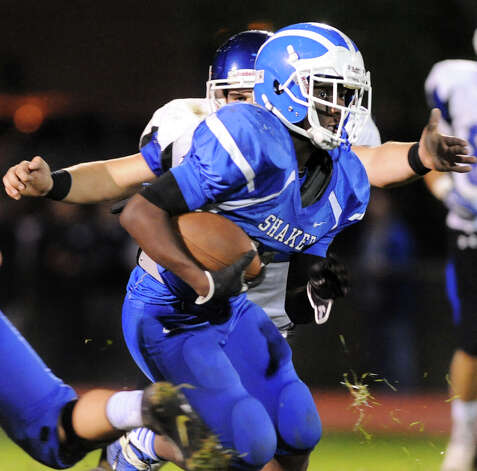 Shaker's Andrew Bolton, right, carries the ball during their football game against La Salle on Thursday, Oct. 2, 2014, at Shaker High in Latham, N.Y. (Cindy Schultz / Times Union) Photo: Cindy Schultz / 00028778A