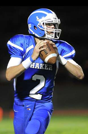 Shaker's quarterback Matt Woods looks to pass during their football game against La Salle on Thursday, Oct. 2, 2014, at Shaker High in Latham, N.Y. (Cindy Schultz / Times Union) Photo: Cindy Schultz / 00028778A