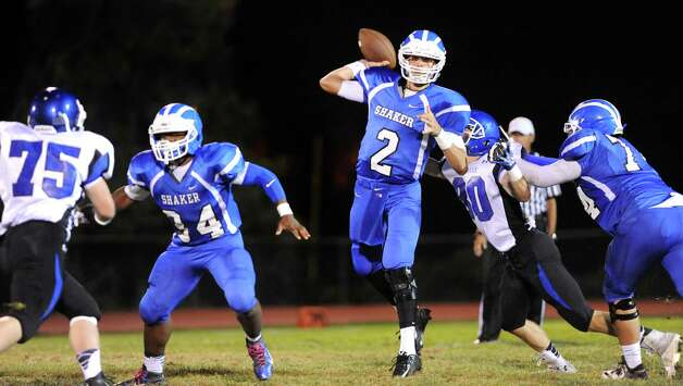 Shaker's quarterback Matt Woods, center, readies the pass during their football game against La Salle on Thursday, Oct. 2, 2014, at Shaker High in Latham, N.Y. (Cindy Schultz / Times Union) Photo: Cindy Schultz / 00028778A