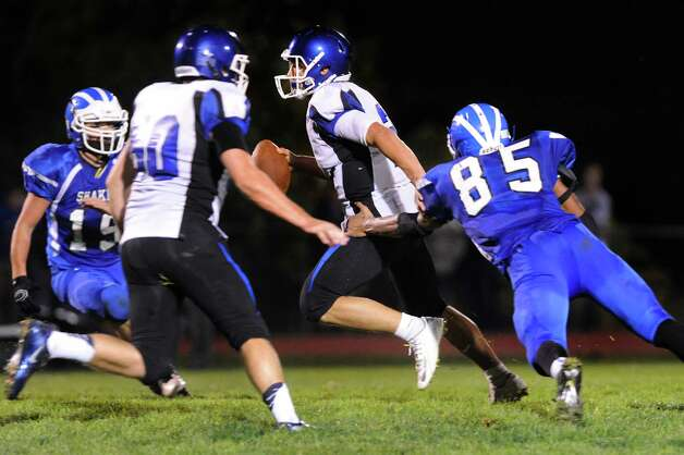 La Salle's quarterback Joe Germinerio, center, gets pressure from Shaker's Brandon Barlow, right, during their football game on Thursday, Oct. 2, 2014, at Shaker High in Latham, N.Y. (Cindy Schultz / Times Union) Photo: Cindy Schultz / 00028778A