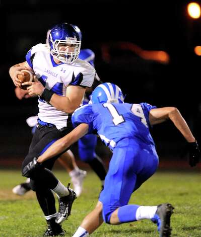 La Salle's Bayley Haskin, left, carries the ball as Shaker's Andrew Nicholson defends during their football game on Thursday, Oct. 2, 2014, at Shaker High in Latham, N.Y. (Cindy Schultz / Times Union) Photo: Cindy Schultz / 00028778A
