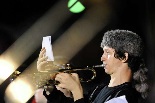 "Trumpet player Zach Andrews, 16, plays ""Sweet Caroline"" with the Shaker High Pep Band during halftime in their football game against La Salle on Thursday, Oct. 2, 2014, at Shaker High in Latham, N.Y. (Cindy Schultz / Times Union) Photo: Cindy Schultz / 00028778A"
