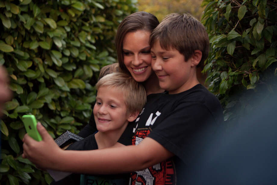 Hilary Swank tanks a selfie with Tyler Johnson, 13, and Ford Johnson, 9, during opening night of the 37th Mill Valley Film Festival in Mill Valley Calif. on Thursday, Oct. 2, 2014. The Johnsons live just up the street and Tyler said he was going to show friends the selfie when he got to school the next morning. Photo: Alex Washburn / Special To The Chronicle / ONLINE_YES