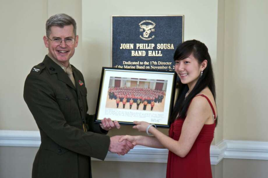 Catherine Chen stands with Col. Michael J. Colburn, conductor of the U.S .Marine Band, Saturday,  after winning the annual Concerto Competition for the nation's top high-school musicians in Washington, DC. Photo: Contributed Photo/Rui Dos Reis, Contributed Photo / Greenwich Time Contributed
