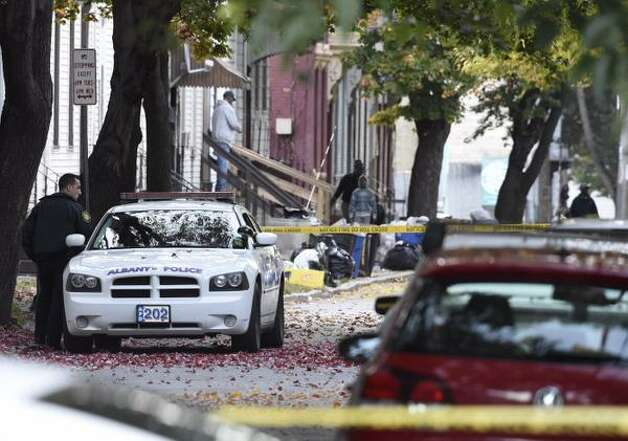 Albany police remain at the scene Friday of a fatal shooting Thursday on First Street. (Skip Dickstein / Times Union)