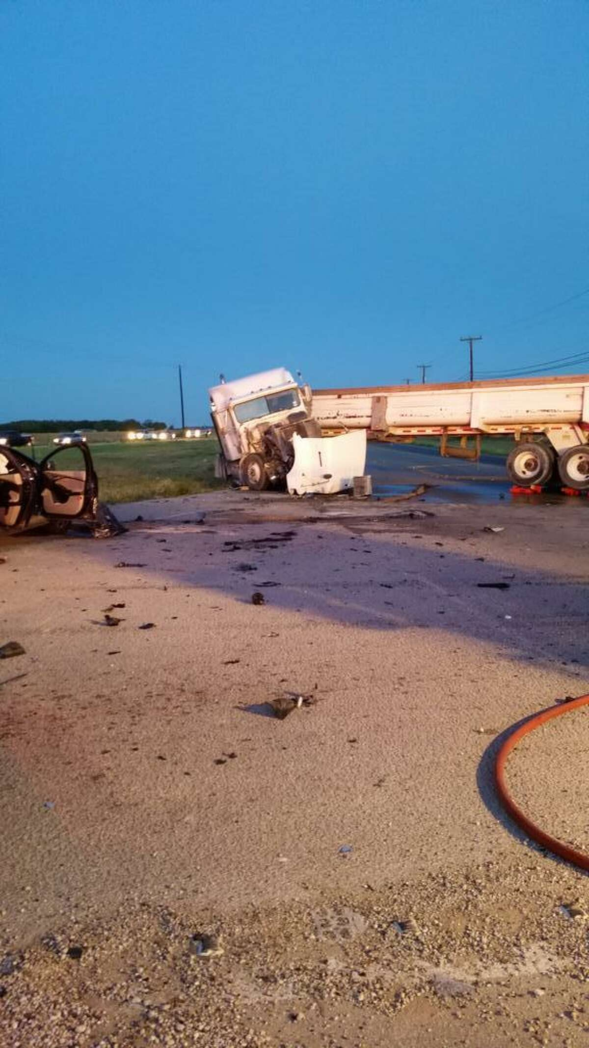 One person is dead after an 18-wheeler swerved to miss a school bus and collided head on with a passenger vehicle at around 6 a.m. Friday in West Bexar County.