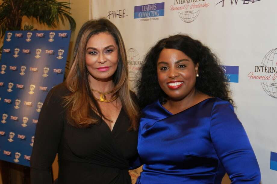 Tina Knowles, left, and Deavra Daughtry at the Texas Women's Empowerment Foundation's 8th annual International Women & Money Leadership Luncheon. (For the Chronicle/Gary Fountain, October 2, 2014) Photo: For The Chronicle