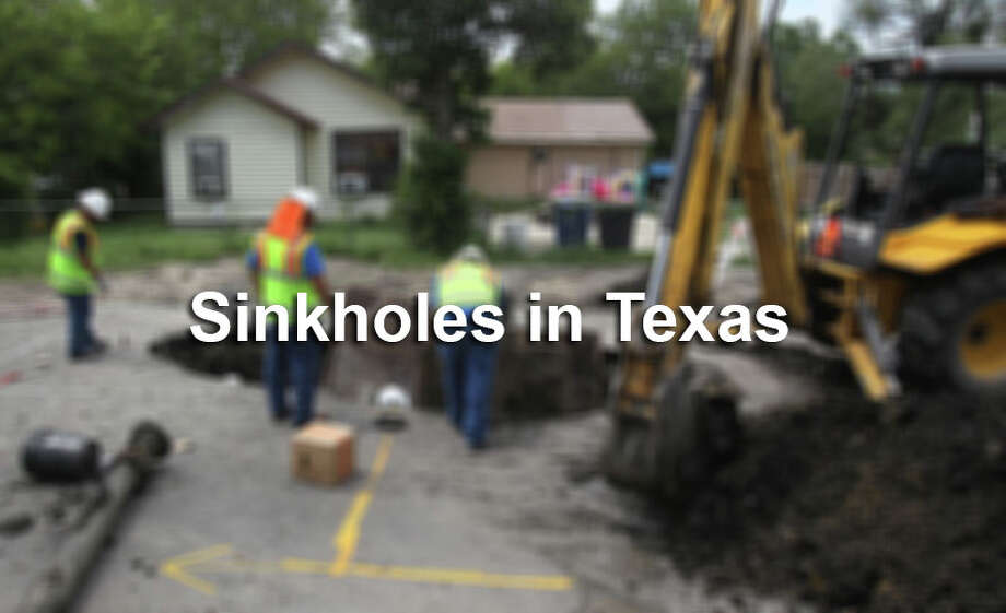 A San Antonio Water System crew works Tuesday August 28, 2012 to repair a water main that blew, creating a large hole in the street on the 500 block of south Elmendorf near the intersection of Cesar Chavez. Photo: John Davenport / San Antonio Express-News