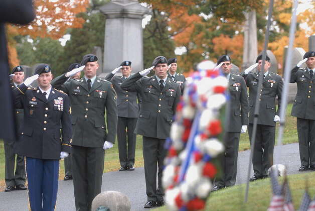 New York Army National Guard soldiers salute as taps is played  during a ceremony to mark the birthday of Chester A. Arthur, the 21st President of the United States, at the Albany Rural Cemetery in Albany, NY on Tuesday, Oct. 5, 2010.   Students in the 4th and 6th grades from the Menands Union Free School District were on hand for the ceremony.  A wreath from President Obama was placed at the gravesite.  (Paul Buckowski / Times Union archive) Photo: Paul Buckowski / 00010522A