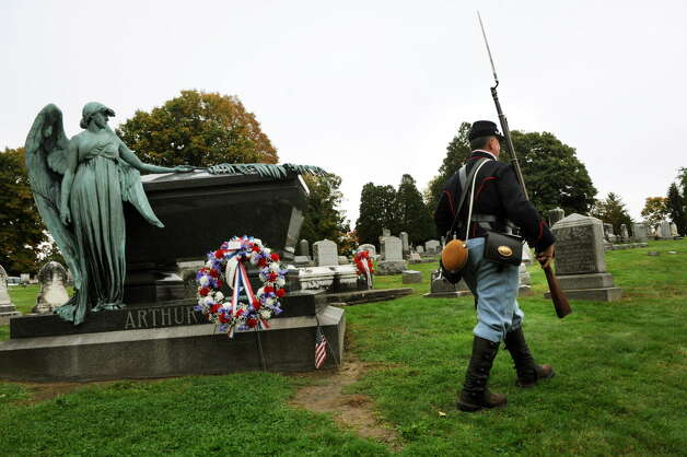 Reenactor Jim Verhagen of Watervliet, portraying a Union infantryman from the Civil War, walks by President Chester A. Arthur's grave on Saturday, Oct. 5, 2013, at Albany Rural Cemetery in Menands, N.Y.  (Cindy Schultz / Times Union archive) Photo: Cindy Schultz / 00024128A