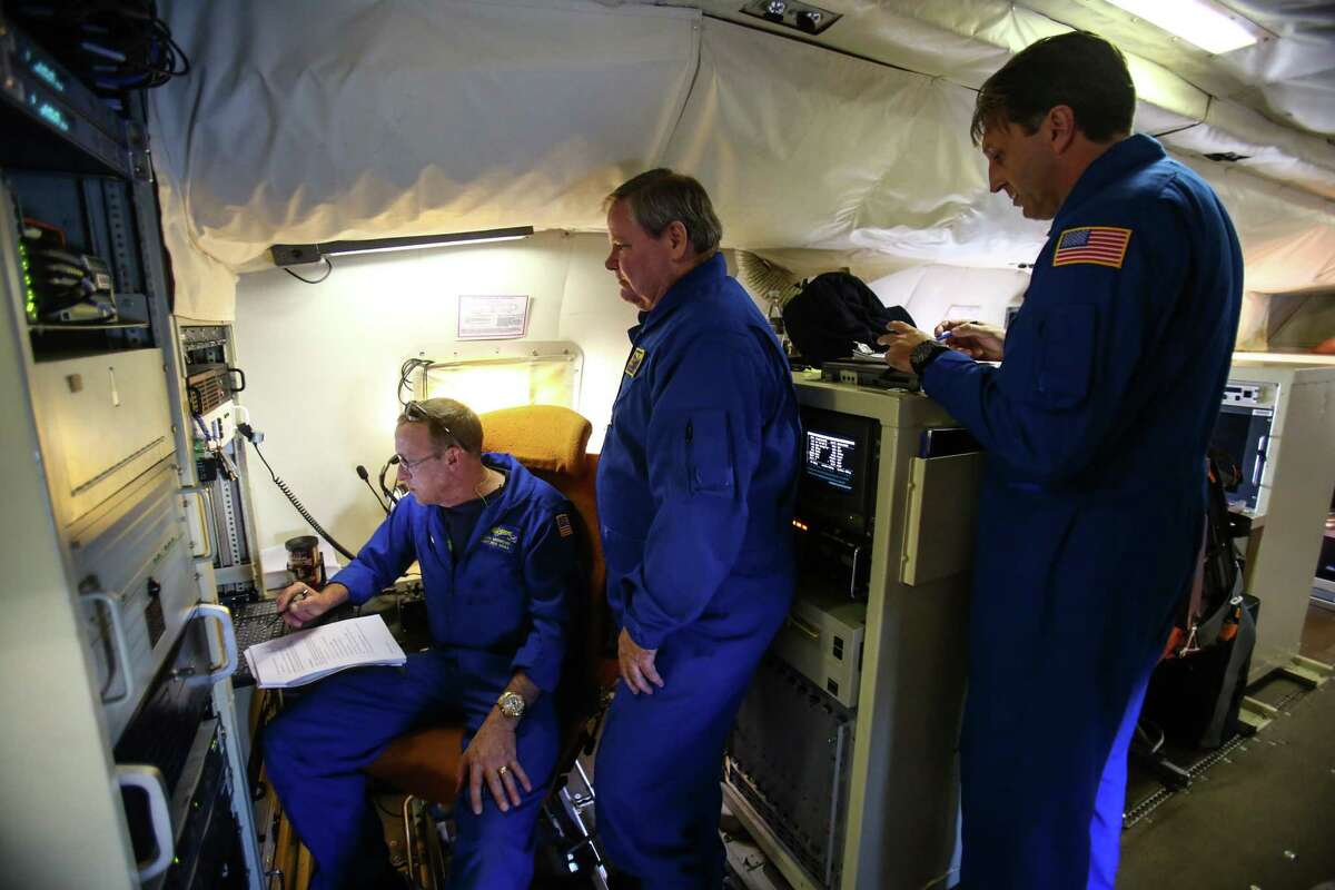 Crew members of the National Oceanic and Atmospheric Administration's P-3