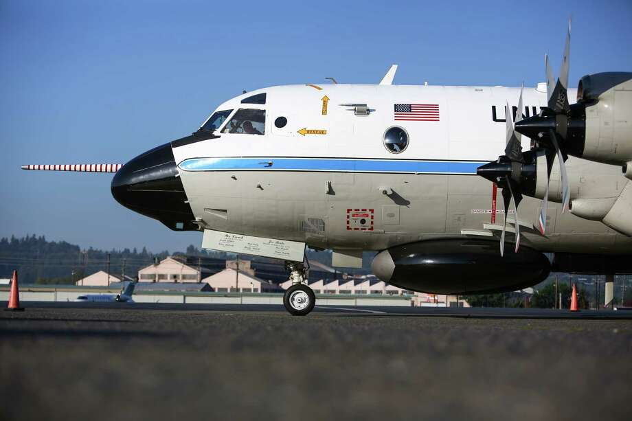 "The National Oceanic and Atmospheric Administration's P-3 ""hurricane hunter"" prepares to depart Boeing Field for a mission to the Arctic. The aircraft will take local scientists to gather atmospheric and oceanic measurements in the transition zone between open water and sea ice in the Beaufort Sea. Photographed on Thursday, October 2, 2014. Photo: JOSHUA TRUJILLO, SEATTLEPI.COM / SEATTLEPI.COM"