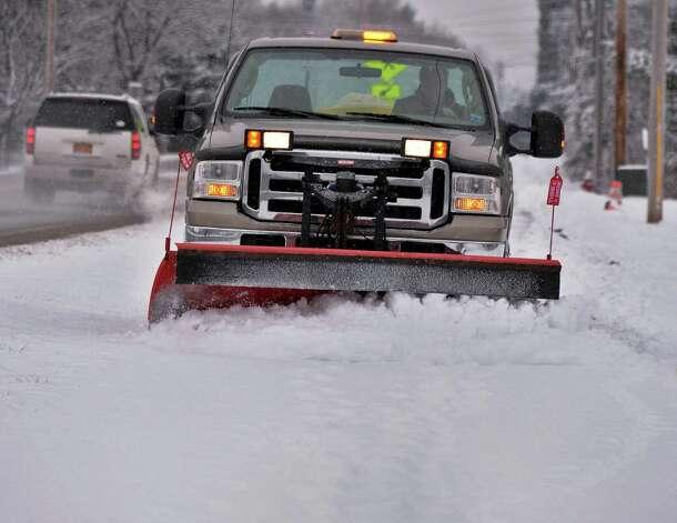 A town DPW truck plows sidewalks along Vischer Ferry Road Thursday Jan. 16, 2014, in Clifton Park, NY.  (John Carl D'Annibale / Times Union) Photo: John Carl D'Annibale, Albany Times Union / 00025401A