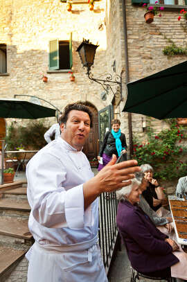 Understanding hand gestures is key to communicating in Italy. Here, an Italian chef uses extra flourishes to proudly describe his menu.