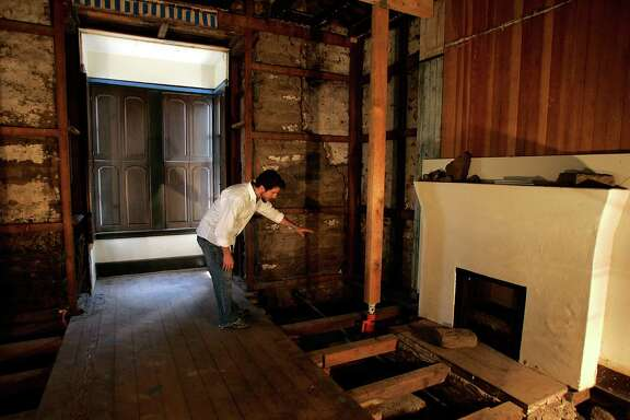 Archaeologist Eric Brandan Blind excavates the walls of the Presidio Officers' Club in June 2005.