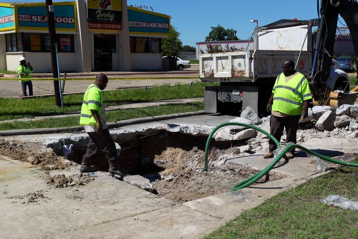 The City of Houston Public Works department repairs a 20-feet wide and 8-feet deep sink hole at the corner of Hilcroft Aveunue and Greenscraig Drive. The hole was caused by two busted storm pipes according to a Public Works employee.