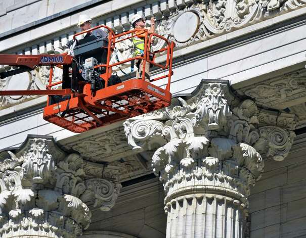 Mason Nate Beckingham, left, and architect Larry Schroeder perform an inspection at the state Education Building Friday Oct. 3, 2014, in Albany,NY.  (John Carl D'Annibale / Times Union) Photo: John Carl D'Annibale