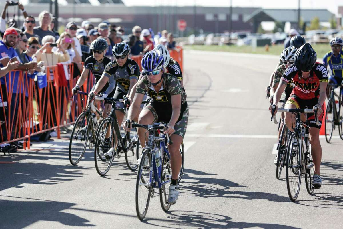U.S. Army Sgt. 1st Class Samantha Goldstein, Warrior Transition Unit, Fort Leonard Wood, Mo., leads the pack out the gate at the start of the Women's Upright Bicycle Open Cycling event during the 2014 Warrior Games, Sept. 29, 2014. More than 200 service members and Veterans participate in the 2014 Warrior Games, an annual event where wounded, ill and injured compete in various Paralympic-style events.