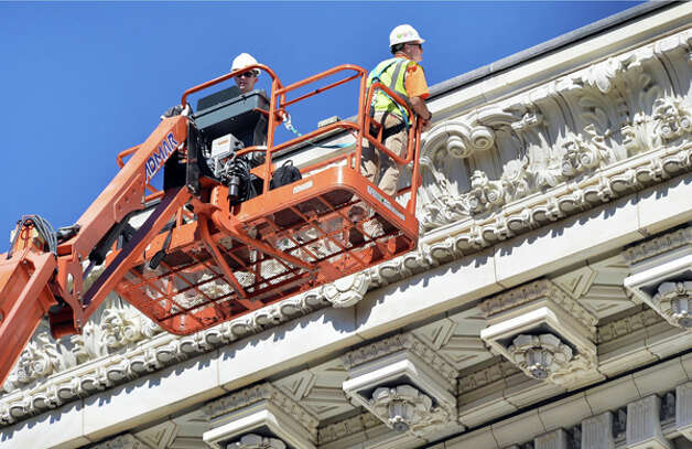 Mason Nate Beckingham, left, and architect Larry Schroeder perform an inspection at the NYS Education Building Friday Oct. 3, 2014, in Albany,NY.  (John Carl D'Annibale / Times Union) Photo: John Carl D'Annibale, Albany Times Union