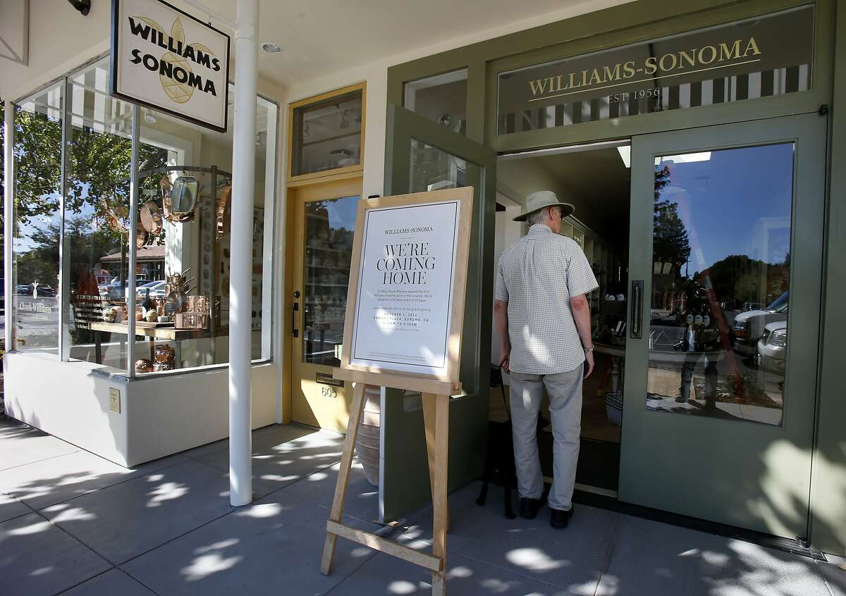John Field peers into the front door of the new Williams Sonoma store on Broadway in Sonoma, Calif. The Williams Sonoma new heritage store is opening at the site of the original shop in Sonoma, Calif. which opened in 1956.