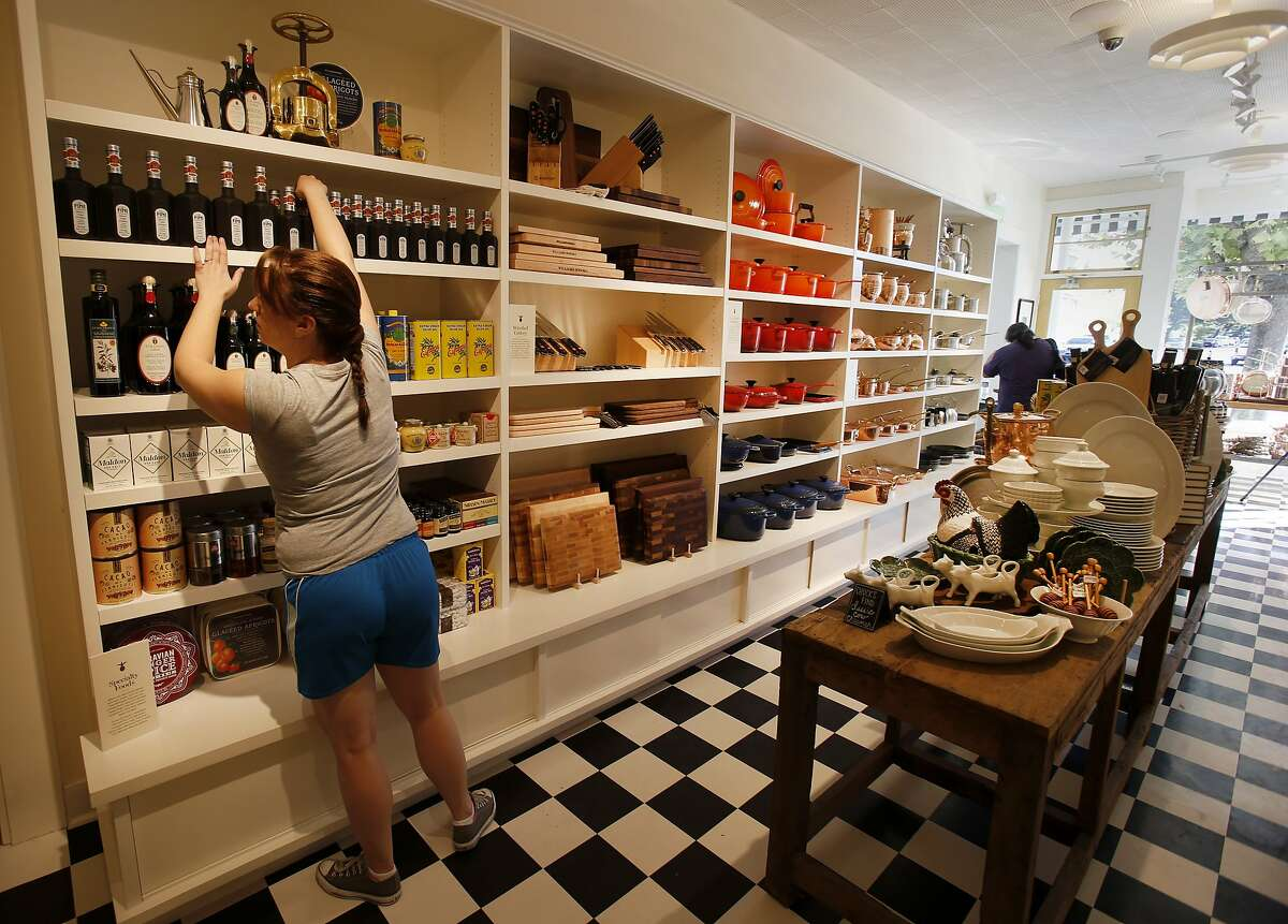 Workers finished stocking shelves in the new original aisle of the store designed to celebrate the first Williams Sonoma store. The Williams Sonoma new heritage store is opening at the site of the original shop in Sonoma, Calif. which opened in 1956.