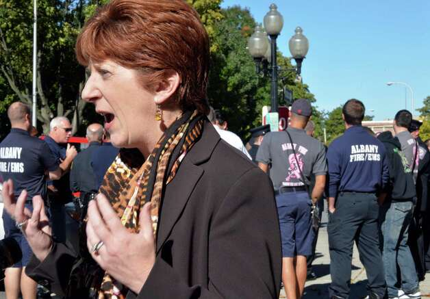 Mayor Kathy Sheehan speaks with reporters outside City Hall before the start of a city firefighters promotion ceremony Friday Oct. 3, 2014, in Albany, NY.  (John Carl D'Annibale / Times Union) Photo: John Carl D'Annibale / 00028872A