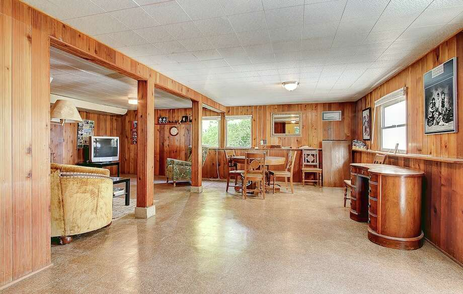 We'll start with the home with the woodiest basement, 13051 Seventh Ave. N.W.. The 2,760-square-foot house, built in 1940, has three bedrooms, 2.75 bathrooms, a sun room, a deck, and views of Puget Sound and the Olympic Mountains on an 8,160-square-foot lot. It's listed for $695,000. An open house is scheduled for 1 p.m. to 3 p.m. on Sunday. Photo: TCPeterson Photography, Courtesy     Jane Powers/Ewing & Clark