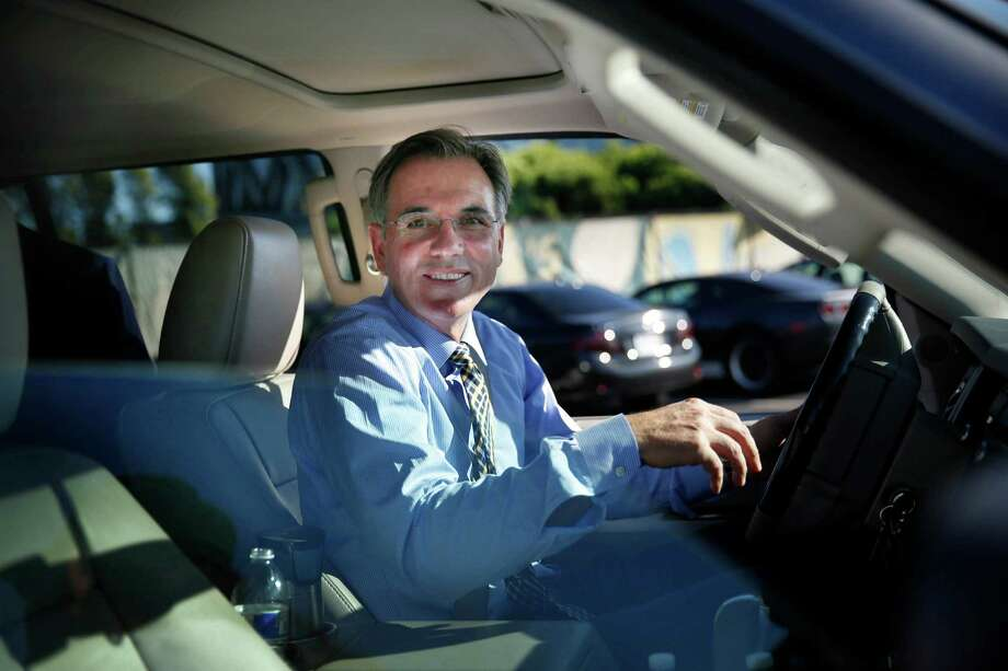 Billy Beane, Oakland Athletics general manager, smiles at fans after signing an autograph for Dave Chavez (not shown) of Alameda as he leaves the Oakland Coliseum on Wednesday, October 1, 2014 in Oakland, Calif. Photo: Lea Suzuki / The Chronicle / ONLINE_YES