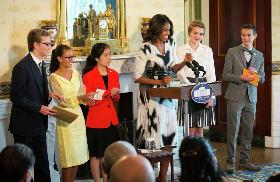 First Lady Michelle Obama hosts a poetry reading in honor of the 2014 National Student Poets from left: Cameron Messinides, Madeleine LeCesne, Ashley Gong, Julia Falkner and Weston Clark in the Blue Room of the White House, Sept. 18, 2014. Photo by Paul Morse Photo: Contributed Photo / The News-Times Contributed