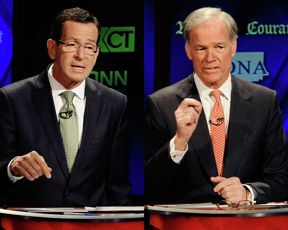 The latest Q poll indicates that incumbent Gov. Dannel Malloy and Republican gubernatorial candidate Tom Foley are in a dead heat.  Photo: AP Photo/Jessica Hill, ASSOCIATED PRESS / AP