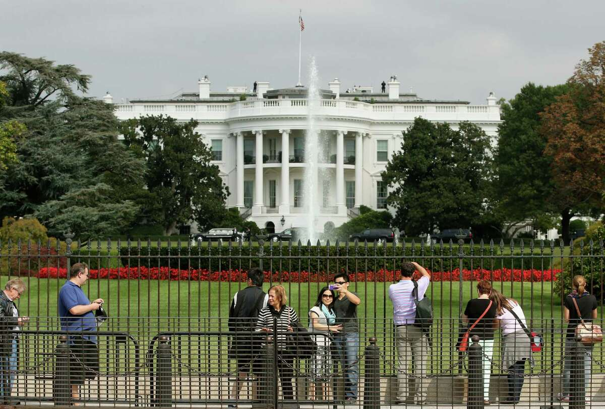 Tourist visit the south side of the White House September 30, 2014 in Washington, DC. A person jumped a pedestrian barrier outside the White House on Saturday, prompting a Secret Service response, according to the Trump administration.