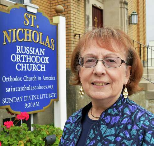 Life-long parisher Stephanie Stroyen of Stoughton, Mass. and Cohoes outside St. Nicholas Orthodox Church Thursday Oct. 2, 2014, in Cohoes, NY.  (John Carl D'Annibale / Times Union) Photo: John Carl D'Annibale / 00028845A