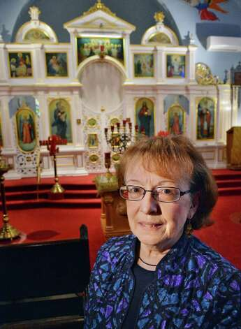 Life-long parisher Stephanie Stroyen of Stoughton, Mass. and Cohoes inside St. Nicholas Orthodox Church Thursday Oct. 2, 2014, in Cohoes, NY.  (John Carl D'Annibale / Times Union) Photo: John Carl D'Annibale / 00028845A