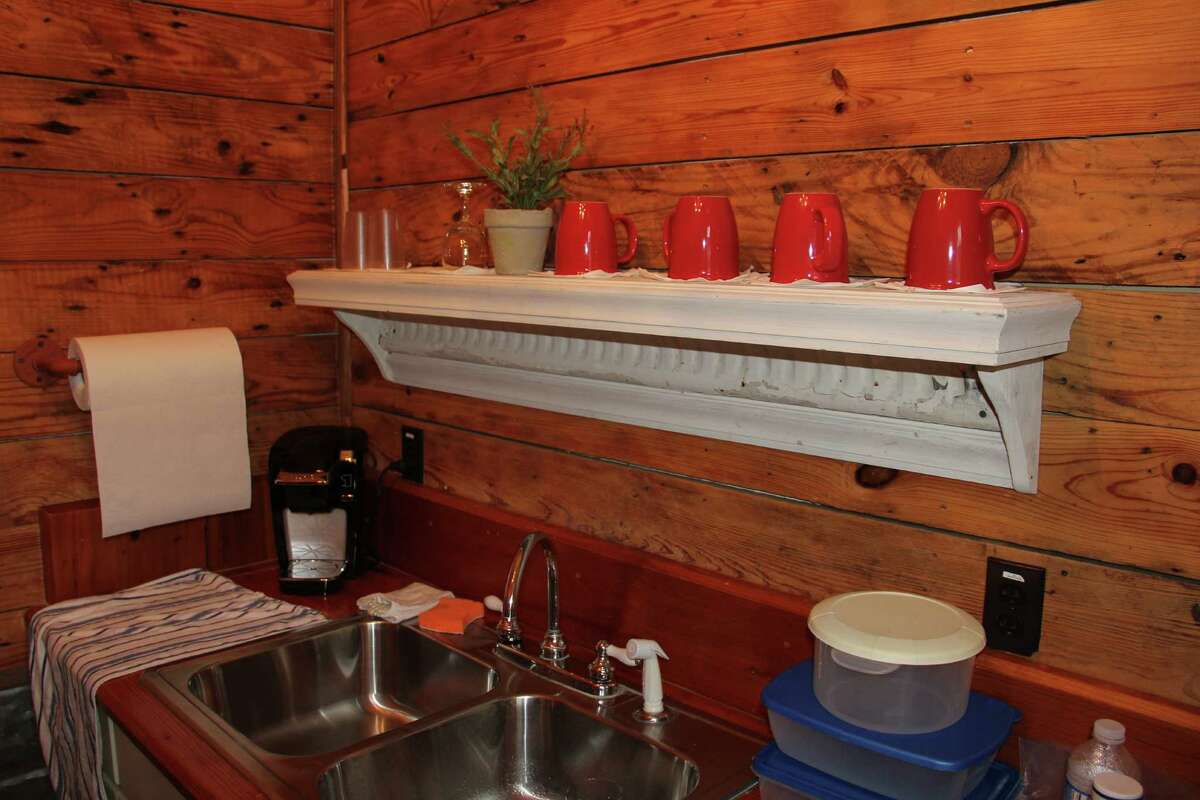 A plumbing pipe towel holder adds rustic charm to the kitchen in the Merriwether Suite at the Gruene Homestead Inn.