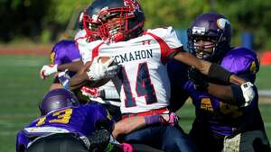 Brien McMahon's Tyre Holman carries the ball during the football game at Westhill High School on Friday, October 3, 2014.