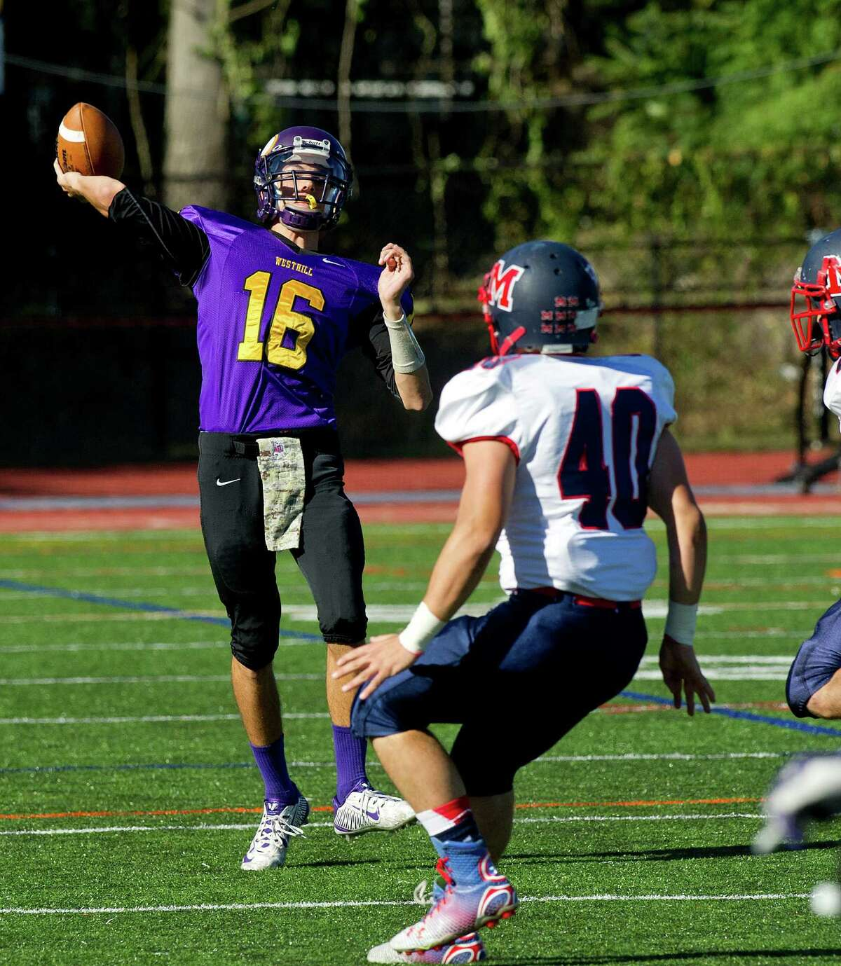 Westhill's Frankie Marcuccio throws the ball during the football game against Brien McMahon at Westhill High School on Friday, October 3, 2014.