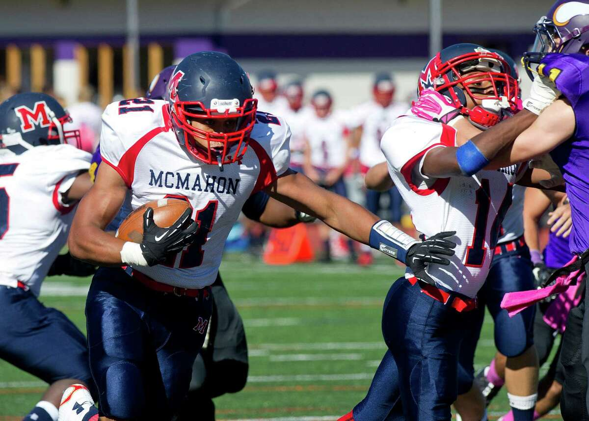 Brien McMahon's Timothy Hinton carries the ball during the football game at Westhill High School on Friday, October 3, 2014.