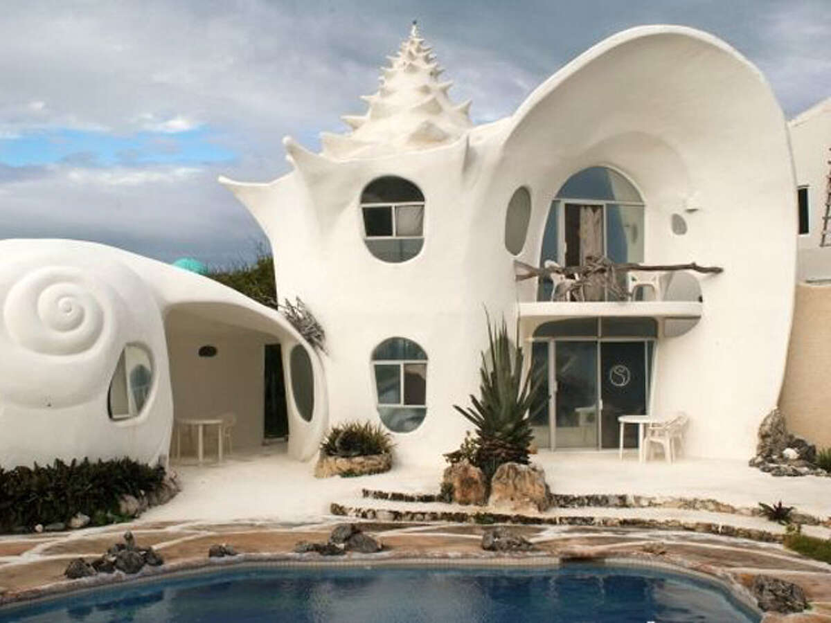 Caribbean Shell House Location: Isla Mujares, Mexico Cost per night: Rates vary Why we love it: With a 180-degree view of the ocean, winding staircases, and a shell-fountain shower, this house offers an offbeat setting for a luxe Caribbean getaway. Rent it here Related Story: 10 tiny vacation homes you can rent across America