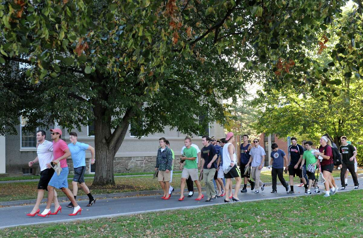 Some of the male students donned high heels for a Walk A Mile In Her Shoes event at Union College on Friday, Oct. 3, 2014 in Schenectady, N.Y. The event was to raise awareness for sexual assault. (Lori Van Buren / Times Union)