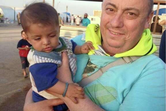 British man Alan Henning, shown in a family photo, was held hostage by the Islamic State group. An Internet video released Friday apparently shows an Islamic State fighter beheading Henning and threatening an American captive.